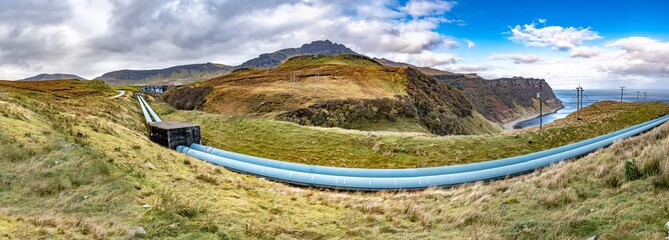 Pipeline of the Storr Lochs hydroelectric power station nestled under the mountains of the Trotternish Peninsula on the Isle of Skye in the West Highlands of Scotland