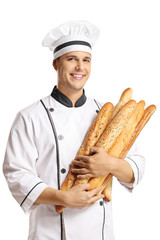 Young male baker holding baguette breads