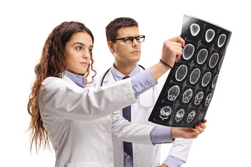 Female and male doctor looking at a x-ray scan