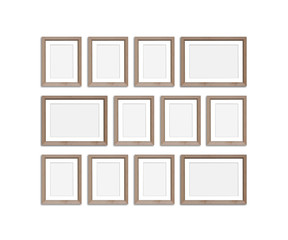 Frames collage, twelve blank wooden frameworks isolated on white background, gallery style mockup. 3D illustration