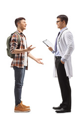 Teenage male student talking to a male doctor