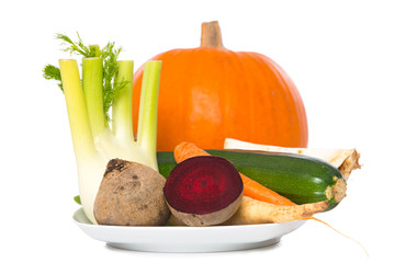 Vegetables on a plate isolated on white background