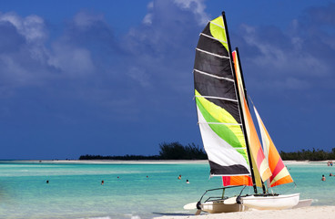 Colorful catamaran on the beach by the ocean