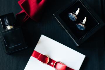 groom's accessories lying on a dark surface, wedding flatlay