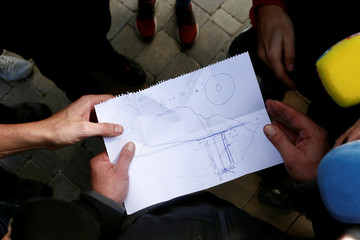 Angel Garcia, delagate of Malaga's Civil Engineers, shows a paper to the journalists with a drawing showing the area where Julen, a Spanish two-year-old boy fell into a deep well four days ago when the family was taking a stroll through a private estate, i