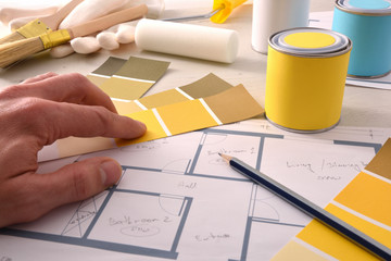 Decorator choosing yellow color for interior home painting project