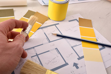 Designer working on interior home painting project elevated view