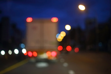 Fotomurales - night light of truck car on the city street, abstract blur bokeh background