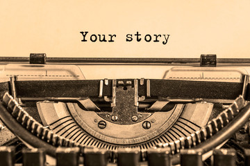 your story is printed on a sheet of paper on a vintage typewriter. journalist, writer.