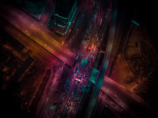 Night traffic on a city roads. Aerial view
