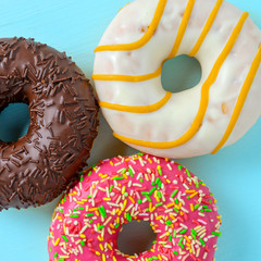 Assorted donuts on blue