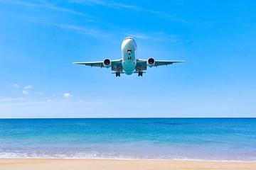 Plane is landing over water