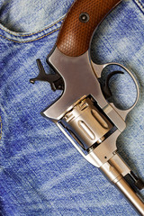 Nagan revolver on blue jeans