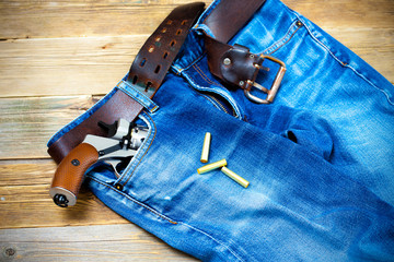 old blue jeans with silver revolver in his pocket
