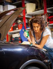 woman car mechanic in a garage