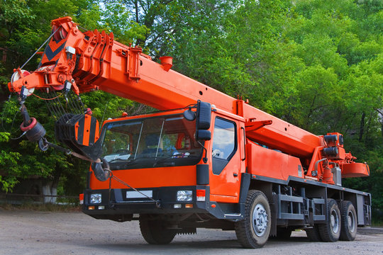 Big Power Mobile Crane on a road and tower crane in construction site