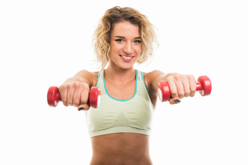Beautiful young fit girl working out with dumbbells