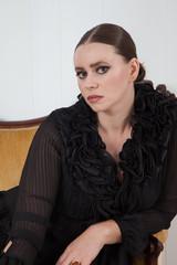 Thoughtful Caucasian woman in a black dress
