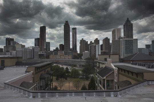Atlanta Skyline on Dark Dwith Cloudsay