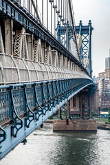 Manhattan Bridge closeup in the morning with colorful cloud over East River in Lower Manhattan in New York City