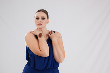Pensive woman in a blue dress