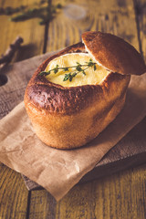 Camembert bread bowl on the wooden background