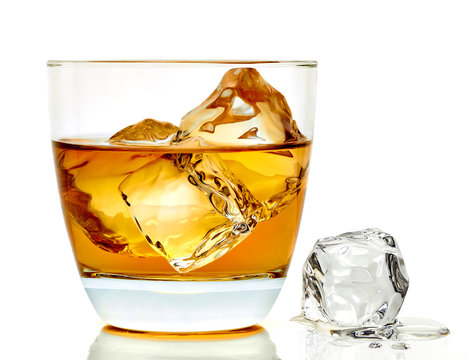 Whiskey with ice cubes in rocks glass isolate on white background