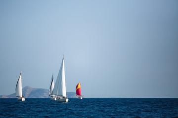 Wall Mural - Luxury sailing boats participate in yacht regatta, Aegean Sea - Greece.