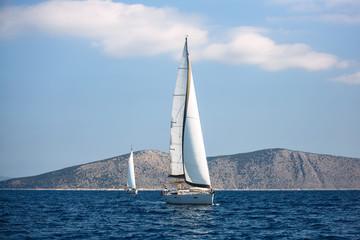 Fototapete - Sailing luxury boats participate in sail yacht regatta, Aegean Sea - Greece.