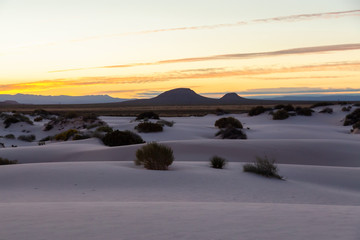 Beautiful view of white sand during a colorful sunrise. Taken in White Sands National Monument, New Mexico, United States.