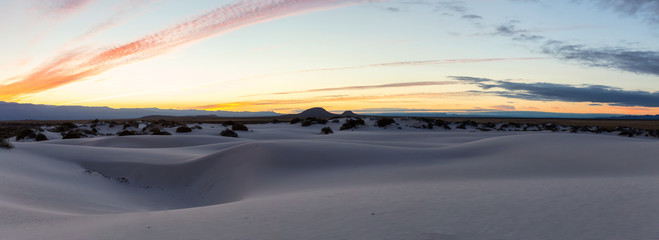 Beautiful panoramic view of white sand during a colorful sunrise. Taken in White Sands National Monument, New Mexico, United States.