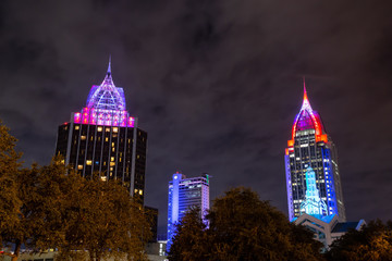 High rise buildings in the downtown city during a cloudy dark night. Taken in Mobile, Alabama, United States.