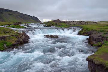 River meandering through the green valley, ring road near Kirkjubæjarklaustur,  Iceland