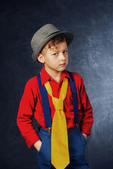 Stylish fashion portrait of boy in Studio on dark background