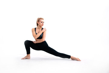 young athletic girl doing stretching