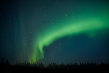 Northern light on Alaska sky dancing trough the night