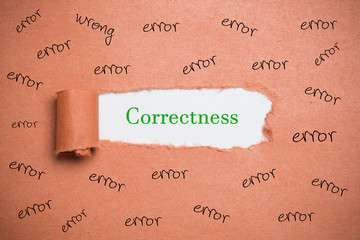 """Torn paper revealing the word """"correctness"""" surrounded by many """"error"""" words"""