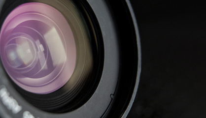 close-up camera lens and black background