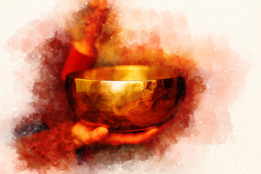 beautiful tibetian bowl with golden light reflections and softly blurred watercolor background.