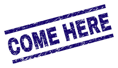 COME HERE seal print with scratced style. Blue vector rubber print of COME HERE text with corroded texture. Text caption is placed between parallel lines.