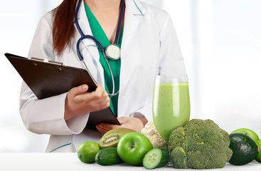 Portrait of  doctor  with  folder and green vegetables and