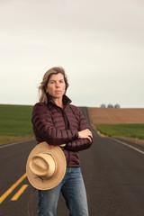 Portrait of woman in jacket standing on road