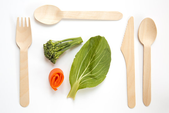 Healthy vegan food with recyclable wooden cutlery