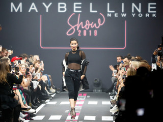 Model Adriana Lima presents a makeup creation by Maybelline New York during the Berlin Fashion Week Autumn/Winter 2019/20 in Berlin