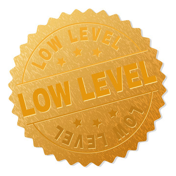 LOW LEVEL gold stamp seal. Vector gold medal with LOW LEVEL text. Text labels are placed between parallel lines and on circle. Golden area has metallic structure.