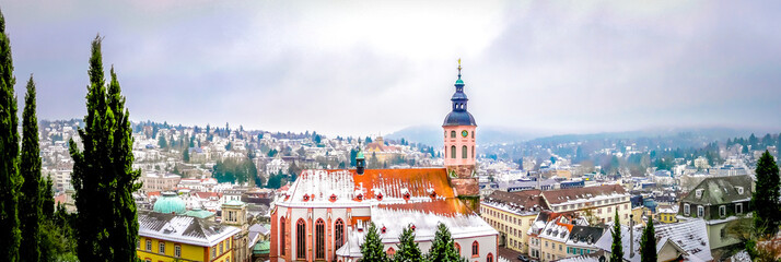 Panoramic view of Stiftskirche church with Baden-baden small cute town in winter fairytale in the Black Forest southwest of Germany. Famous German city with spa for vacations, holidays.