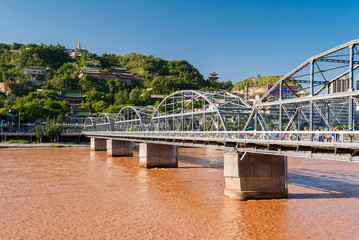 The Zhongshan Bridge in Lanzhou (China) during a sunny afternoon