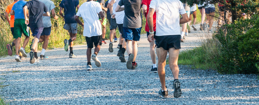 Runners on gravel shot from behind