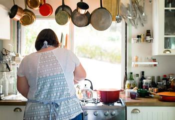 Woman preparing dinner in the kitchen