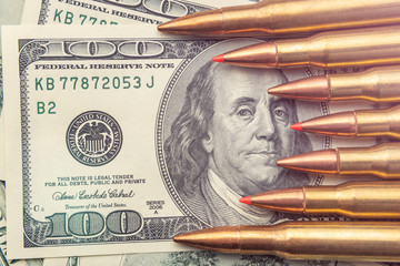 combat bullets from the army machine macro on the banknotes of $ 100. The concept and symbol of a strong army defense of the country